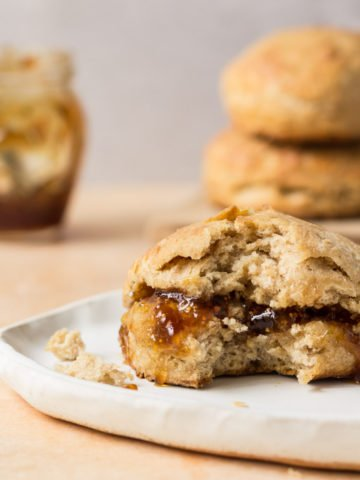 Sourdough biscuits with fig jam on a plate