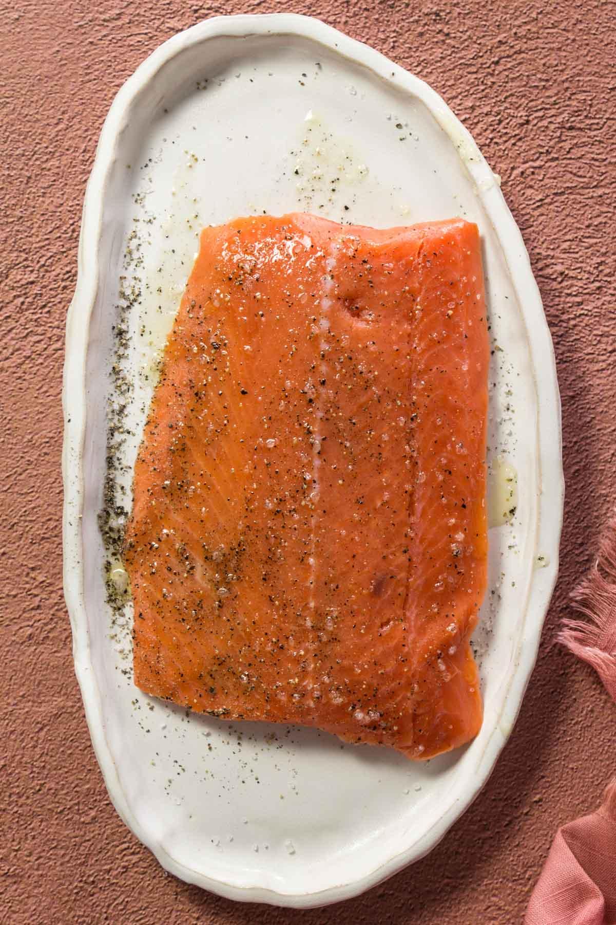 Seasoned Sockeye salmon on a white plate