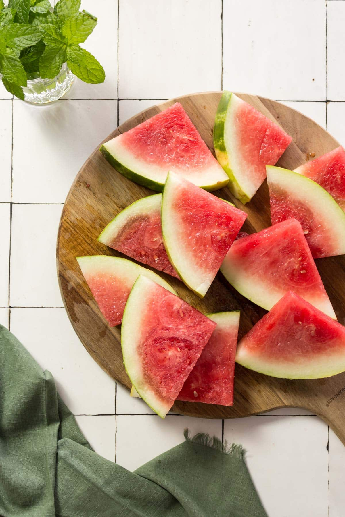 Slices of watermelon on a wooden board