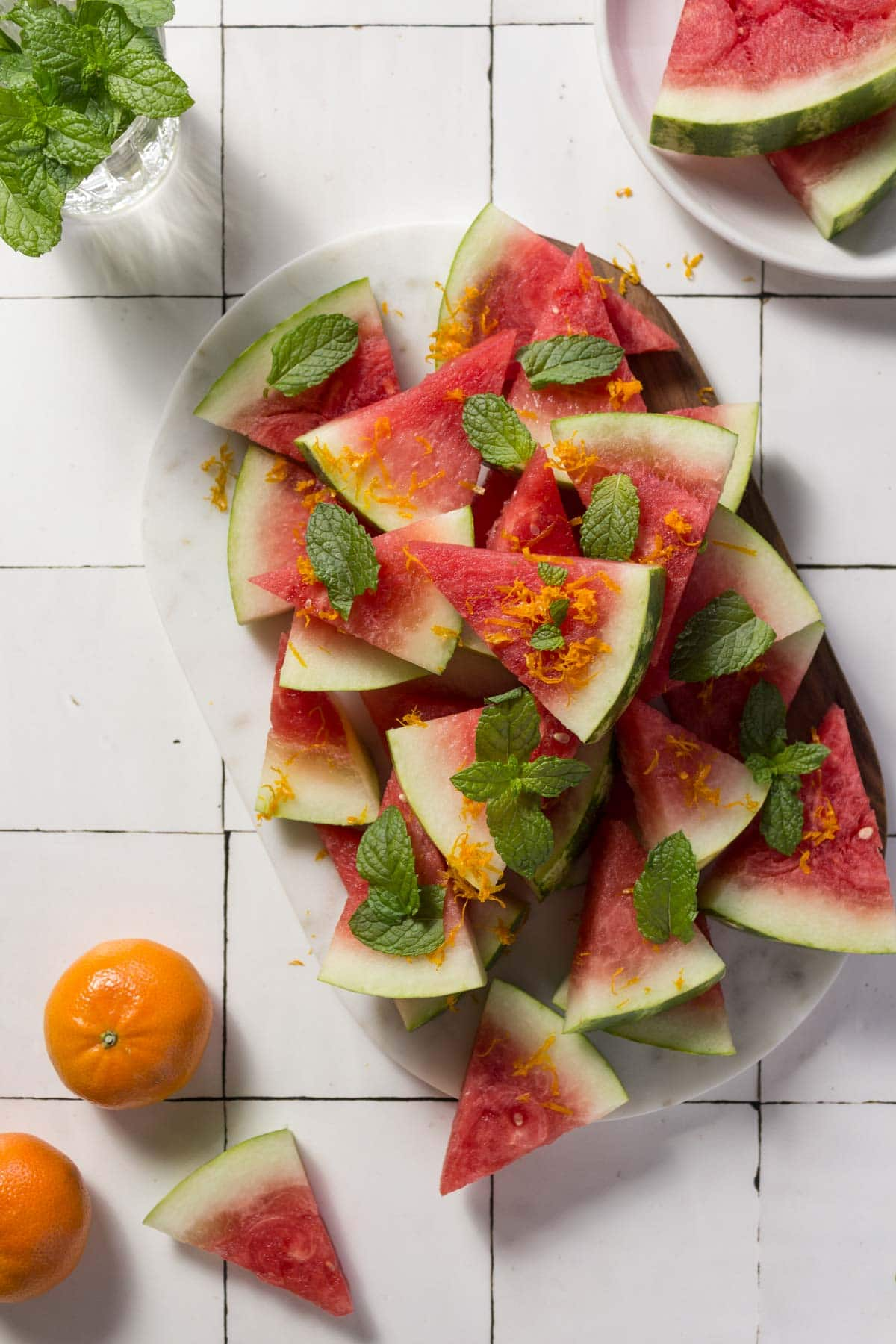 Watermelon salad with mint on a marble board