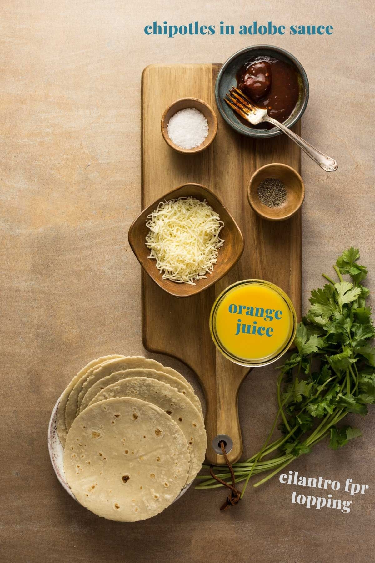 Chipotle orange taco ingredients on a wooden board