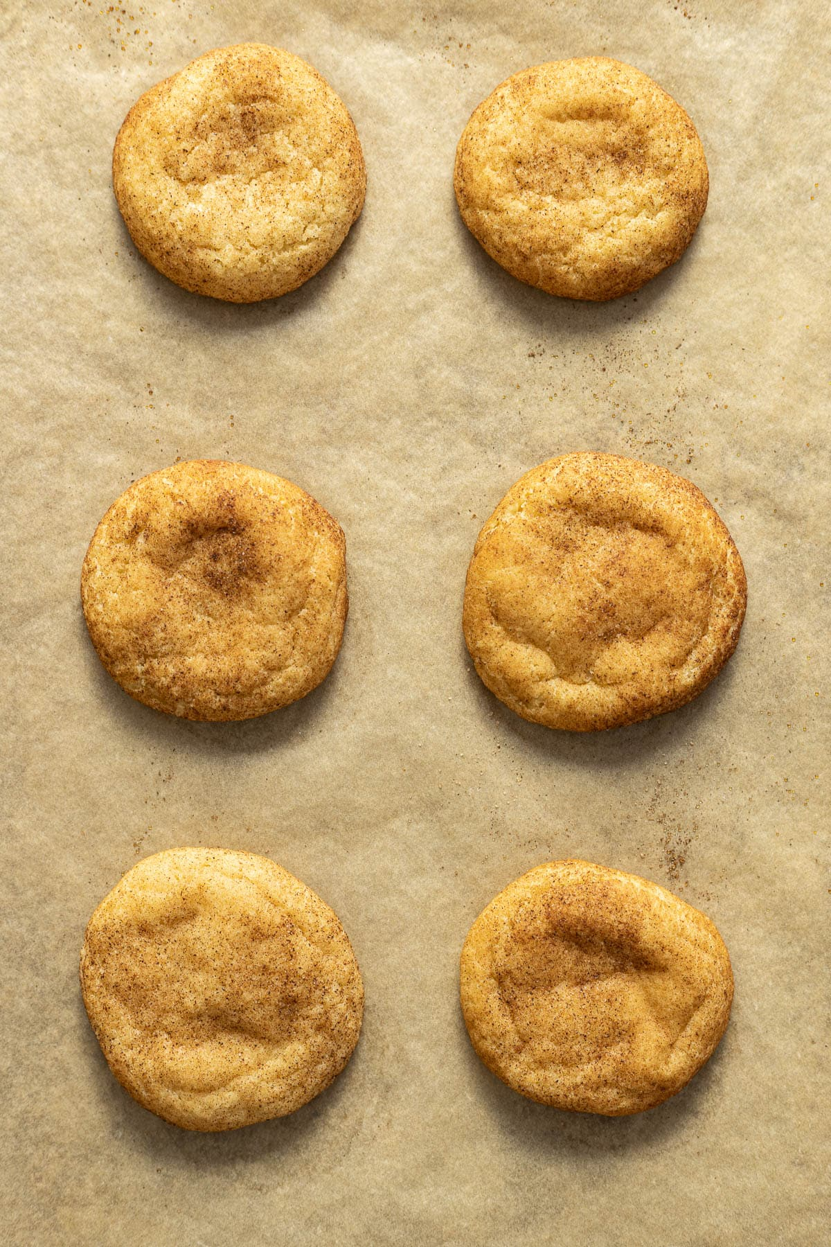 Chai Snickerdoodles baked on parchment paper