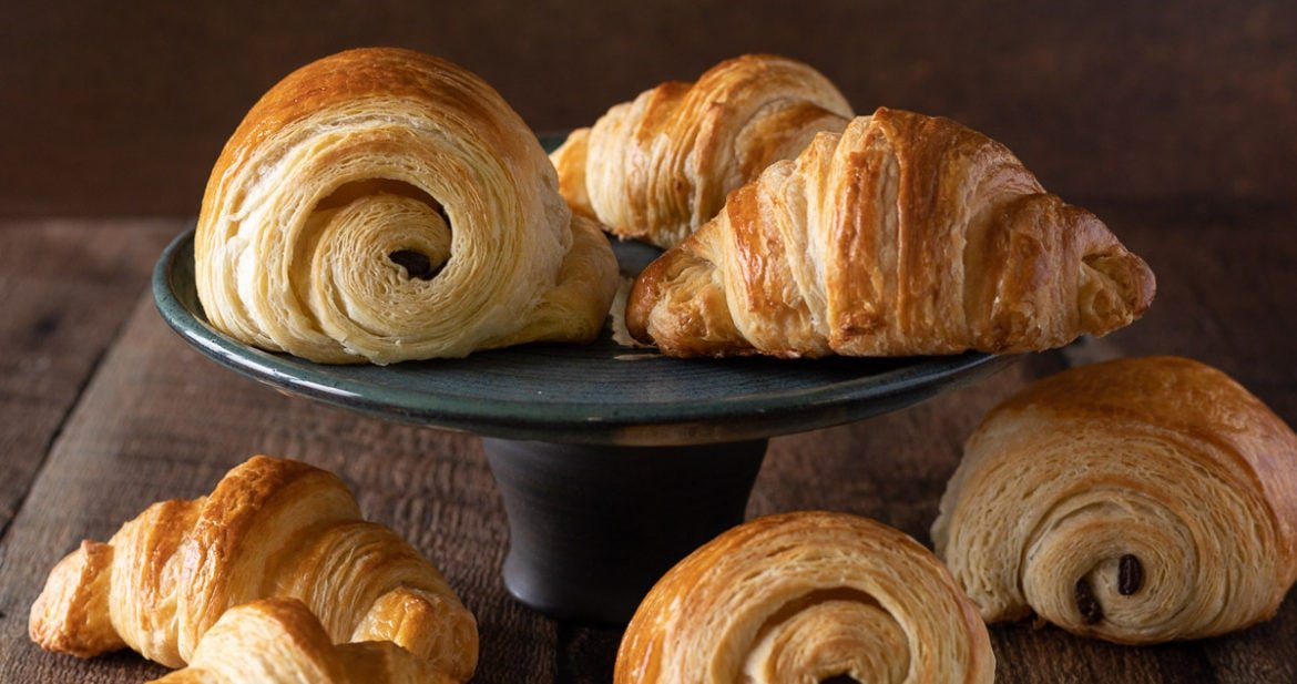 A black plate of French Croissants