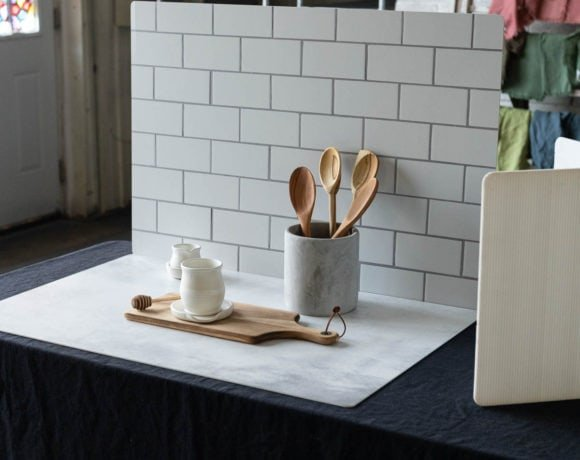 Photography backdrops standing up with a kitchen canister and wooden spoons