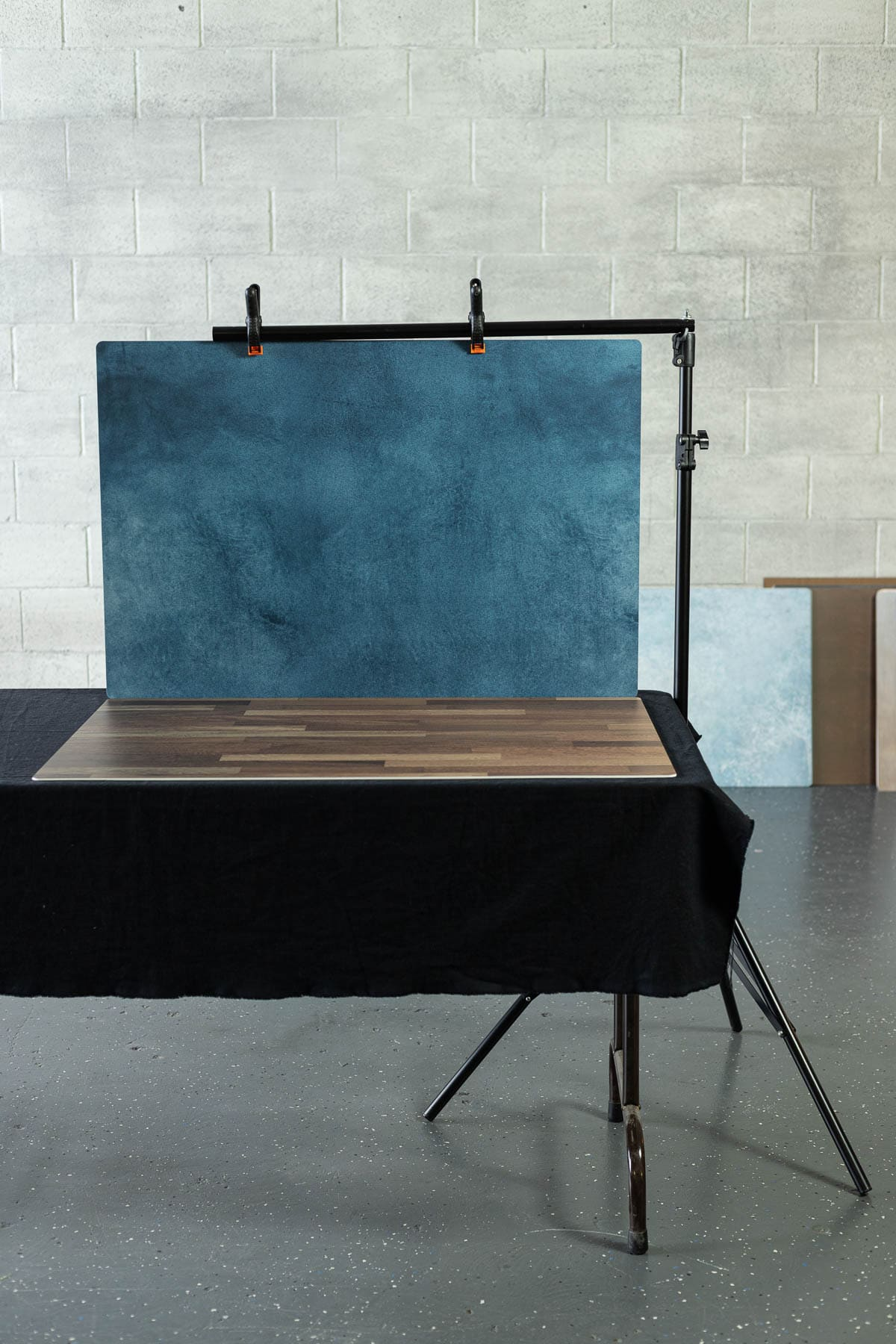 A photography stand hanging up a backdrop
