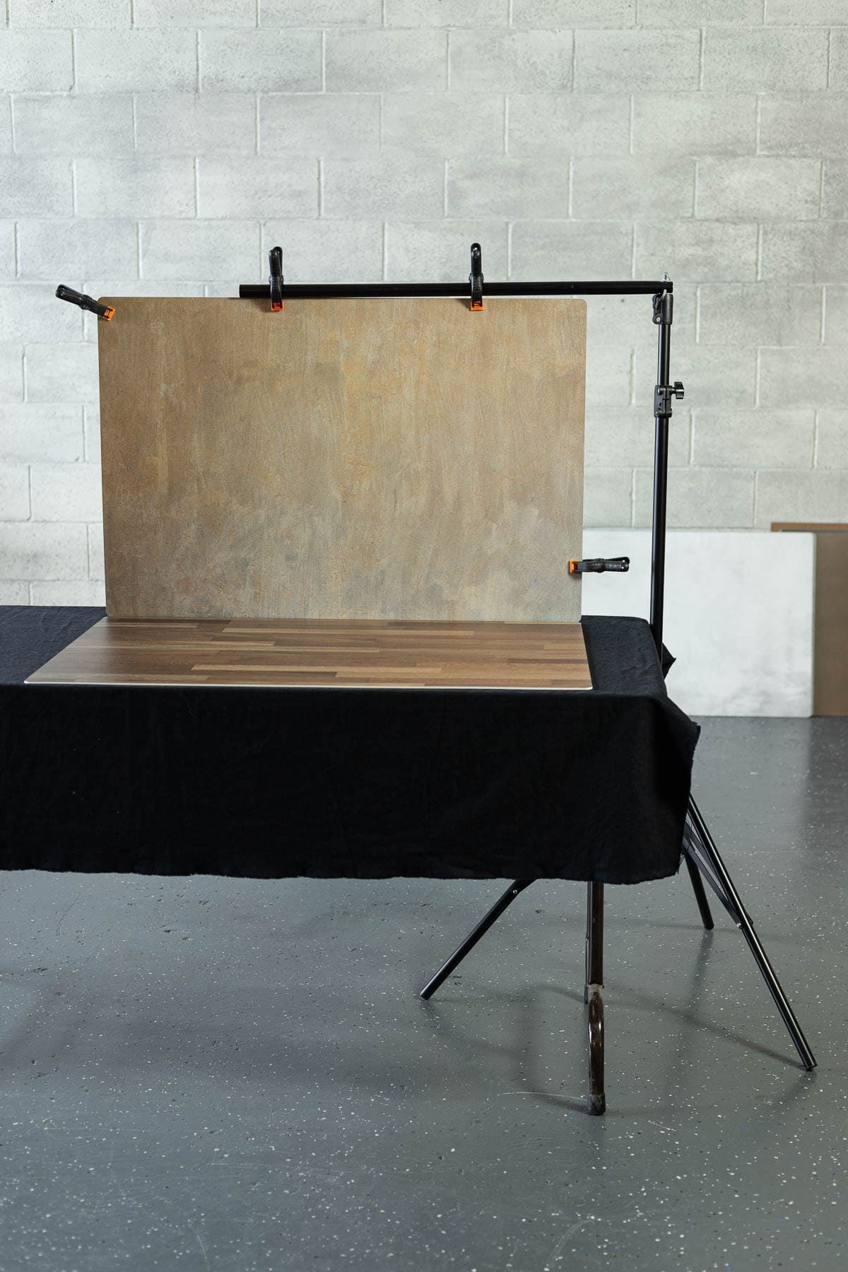 Two photo backdrops clipped to a photography stand