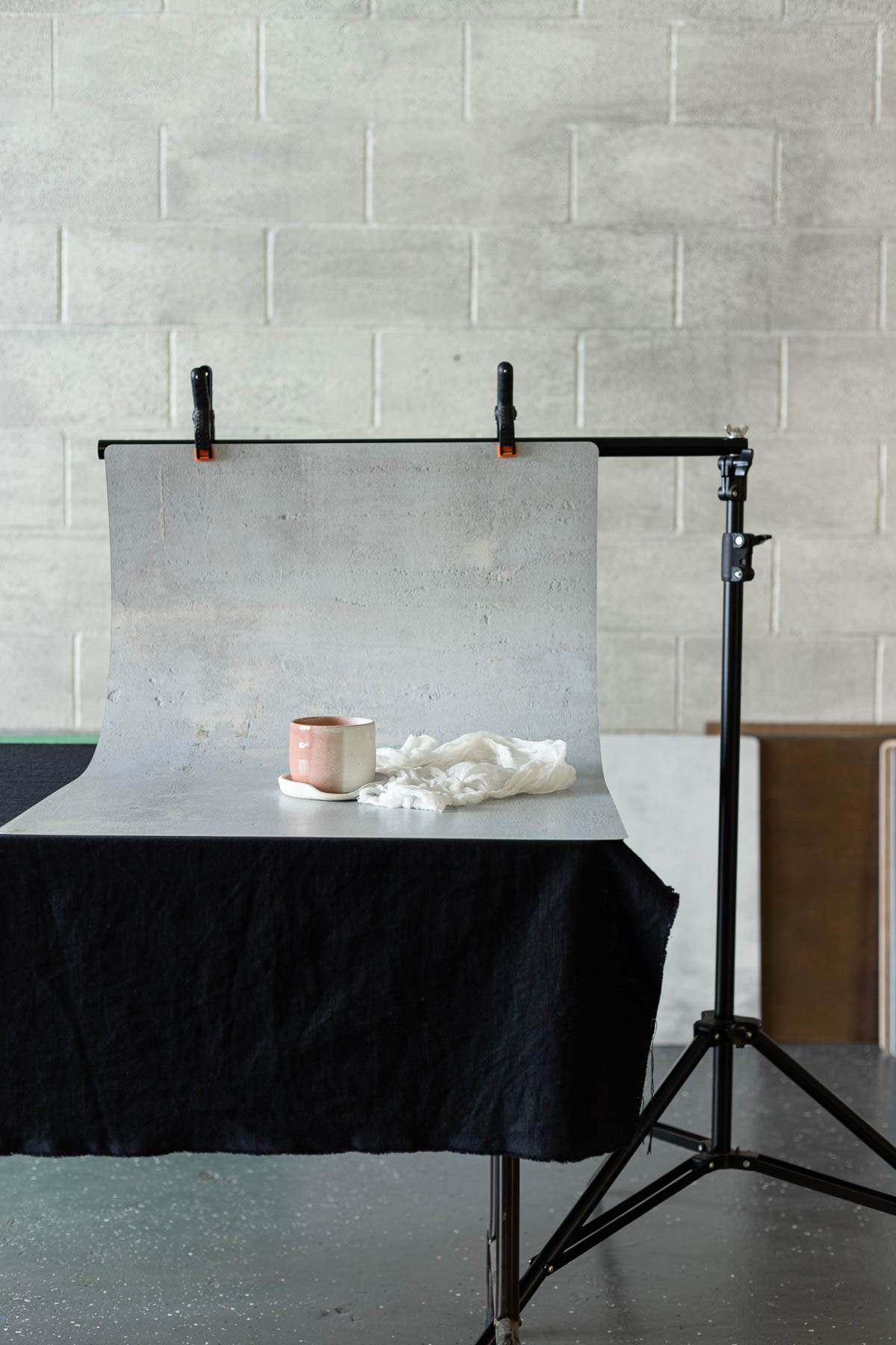 backdrop with a pink cup held up with a photo stand
