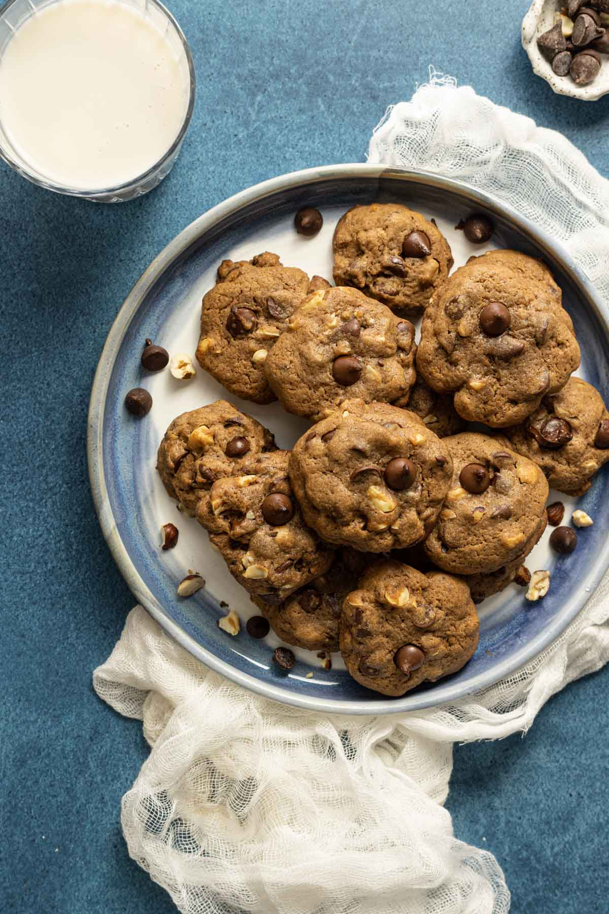 A plate of double chocolate chip cookies with milk