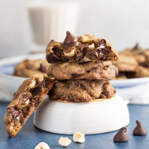 Double chocolate chip cookies stacked on a bowl
