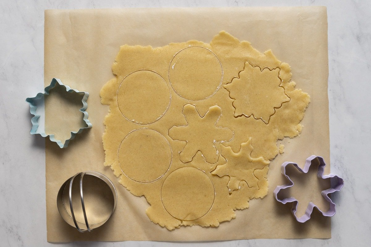 Almond shortbread cookie dough with cookie cutters
