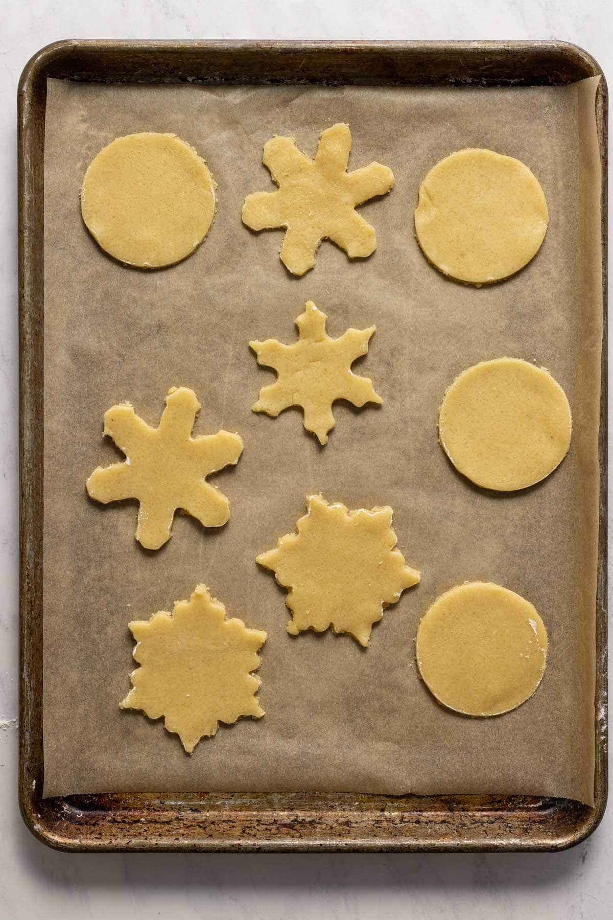 Almond shortbread cookies on a sheet pan