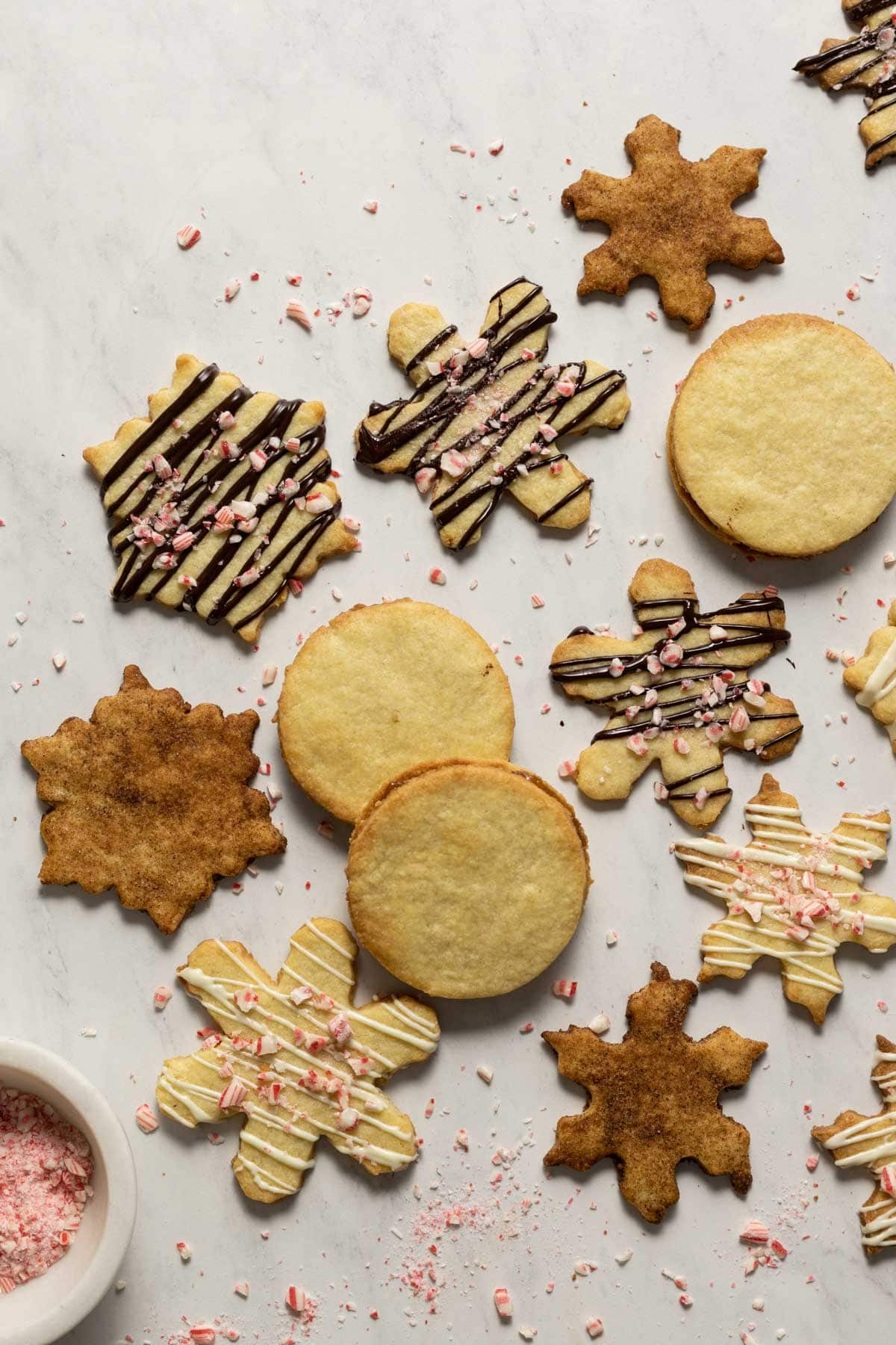 Almond cookies decorated with dark chocolate, chai spice, and white chocolate
