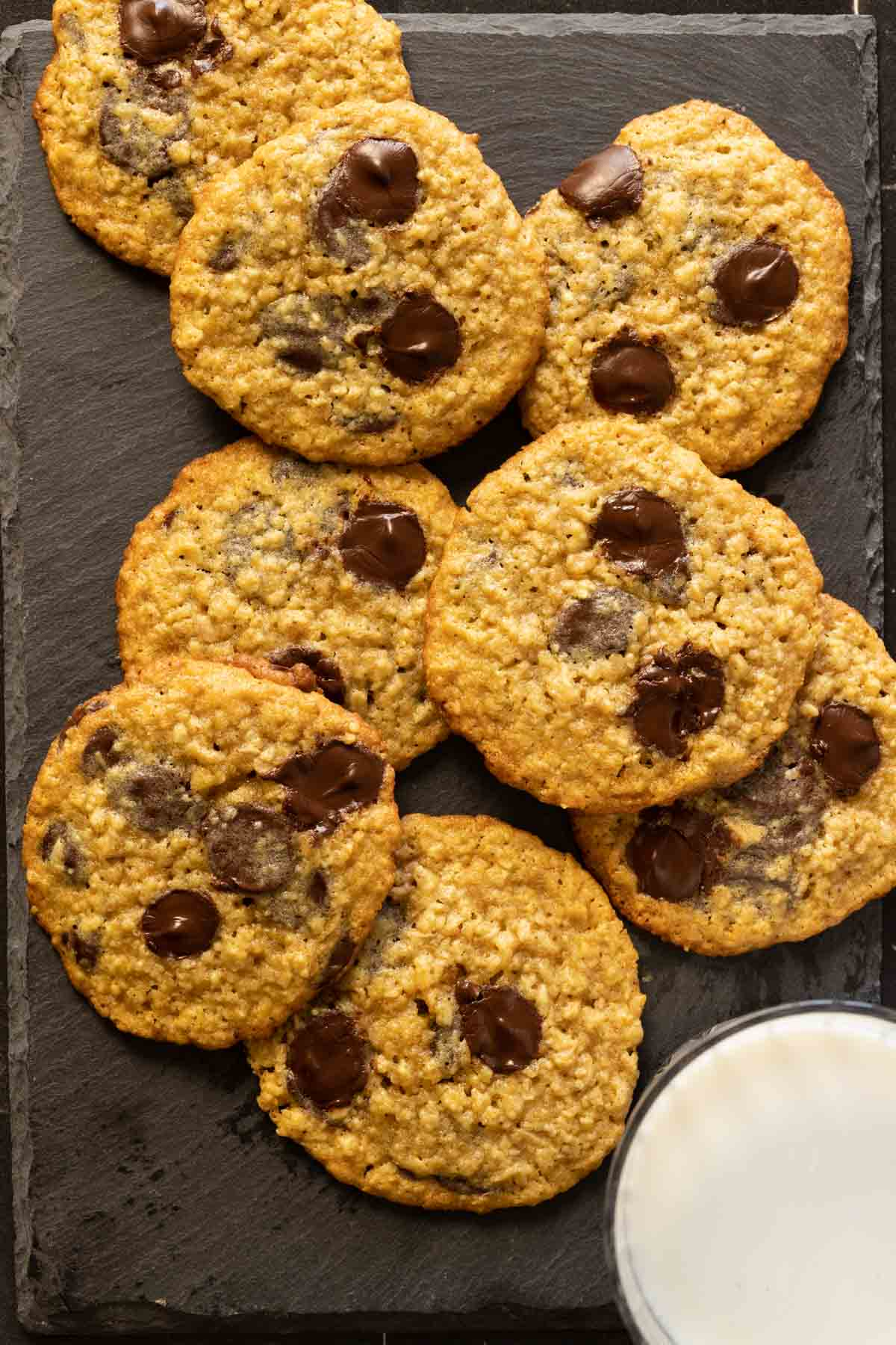 oatmeal chocolate chip cookies with a glass of milk