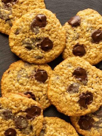Oatmeal chocolate chip cookies on slate tile