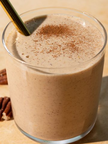Close up of Banana bread smoothie on a yellow background