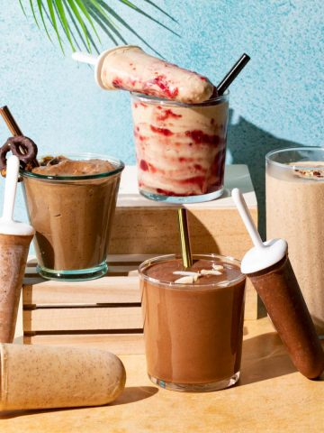 Chocolate and peanut butter smoothies in glasses and popsicles