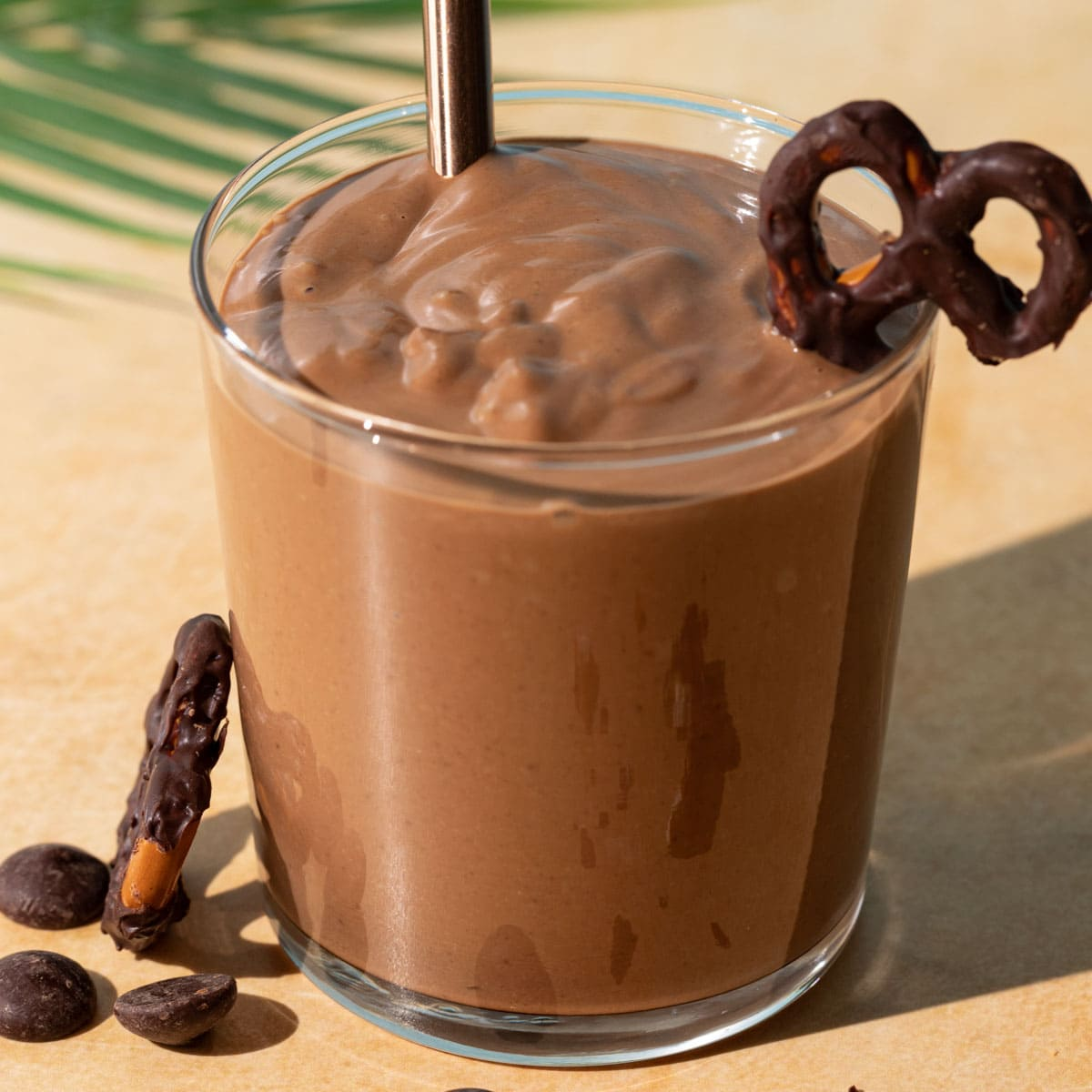 Close up of Chocolate Peanut Butter Pretzel smoothie on a yellow background