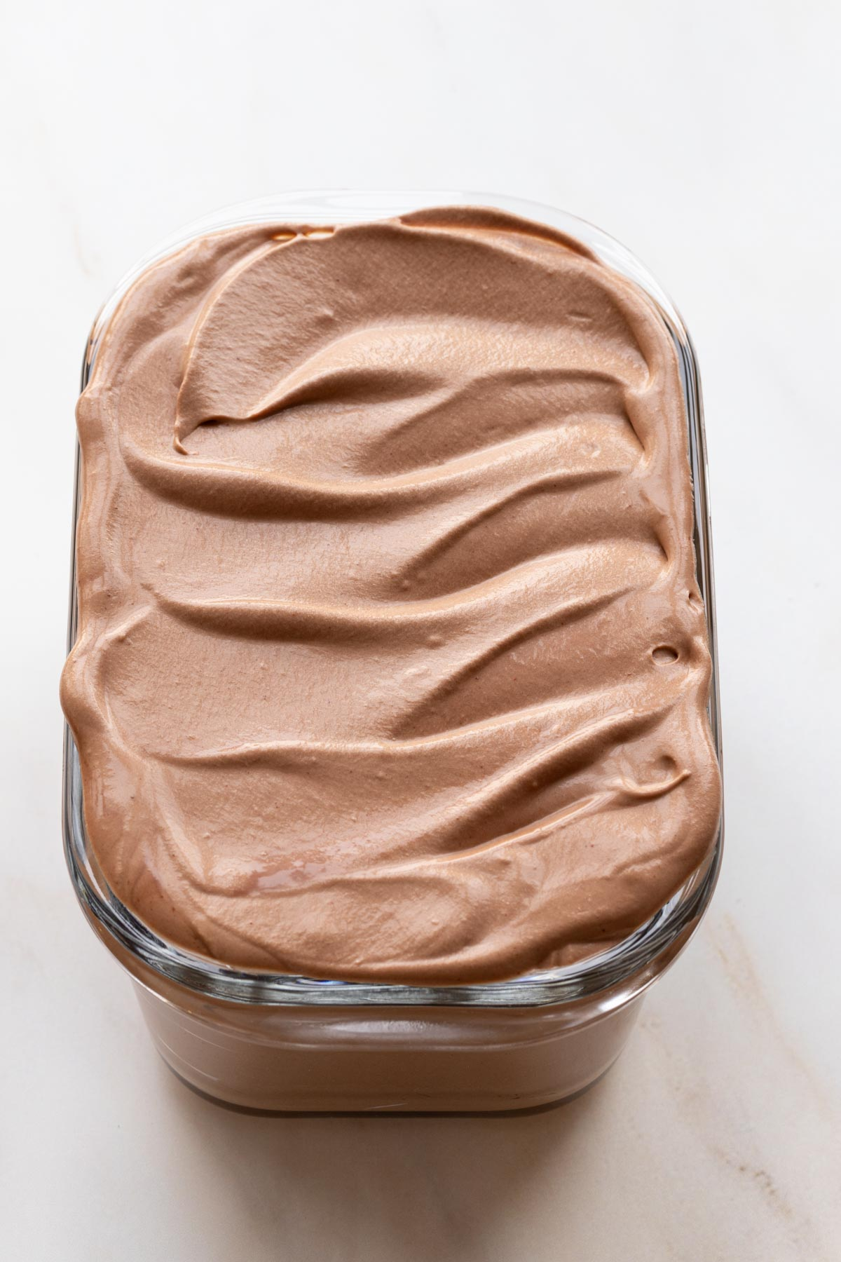 Chocolate no churn ice cream base in a glass container