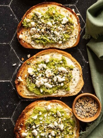 Avocado toasts with goat cheese and a bowl of bagel seasoning