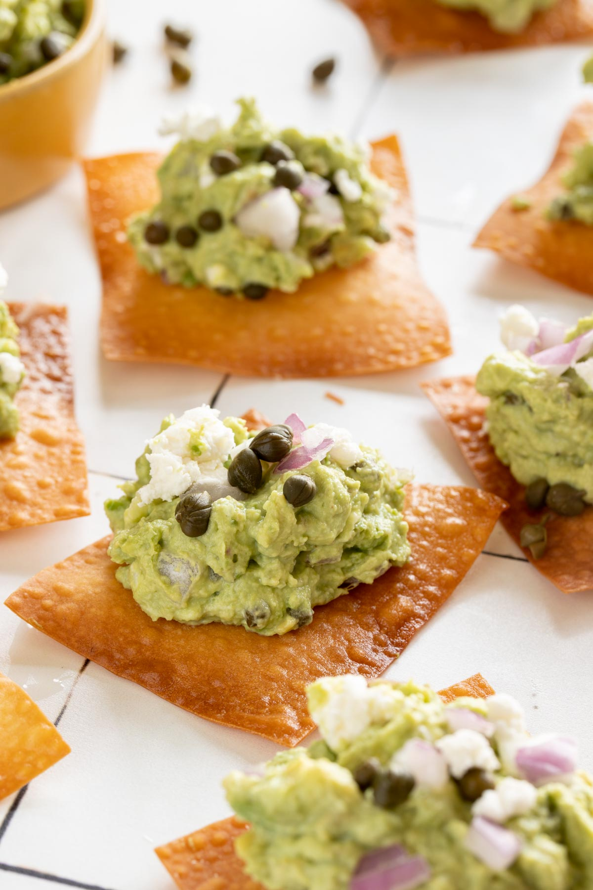 Goat cheese guacamole with wonton skins