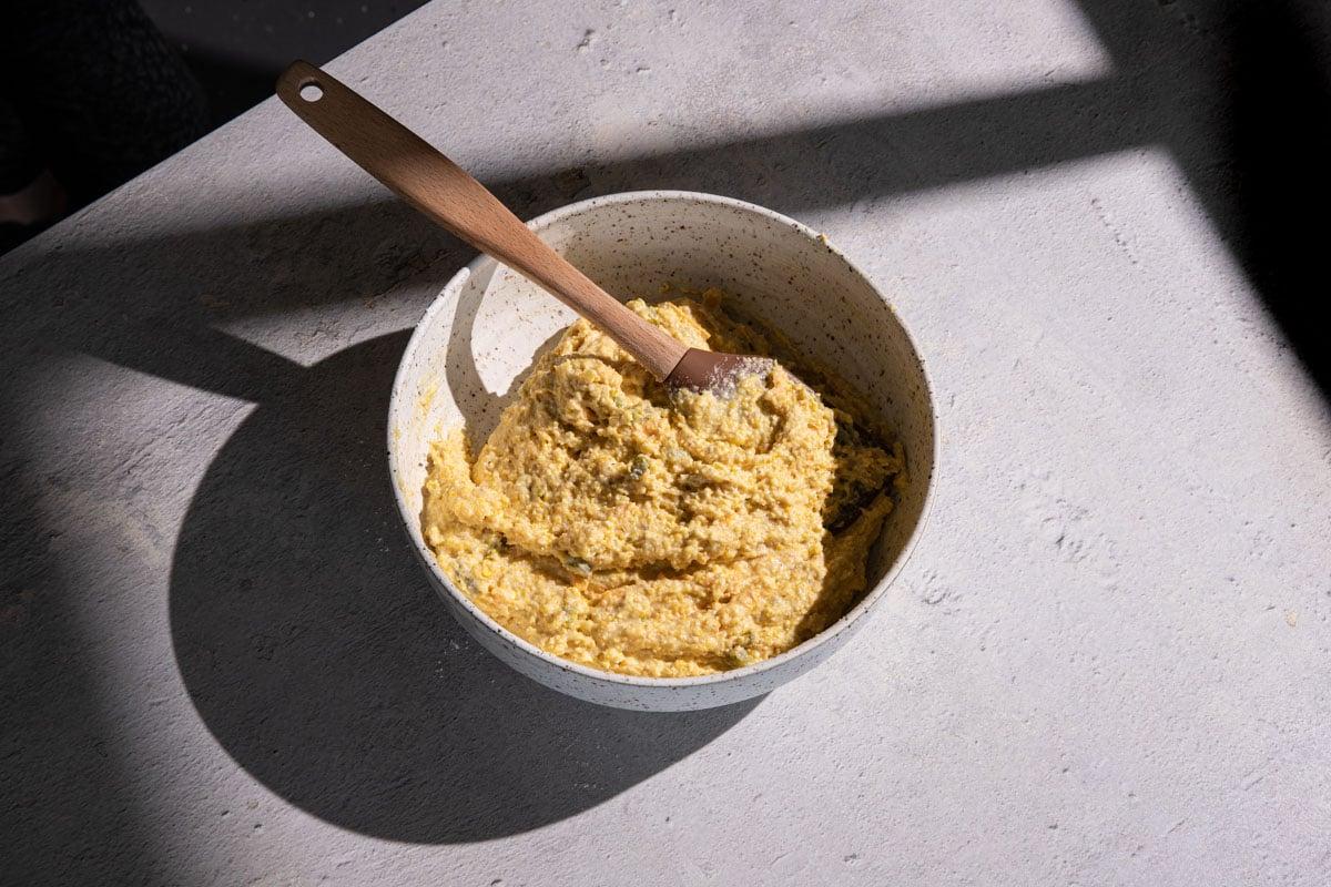 Cornbread batter in a bowl with a spatula