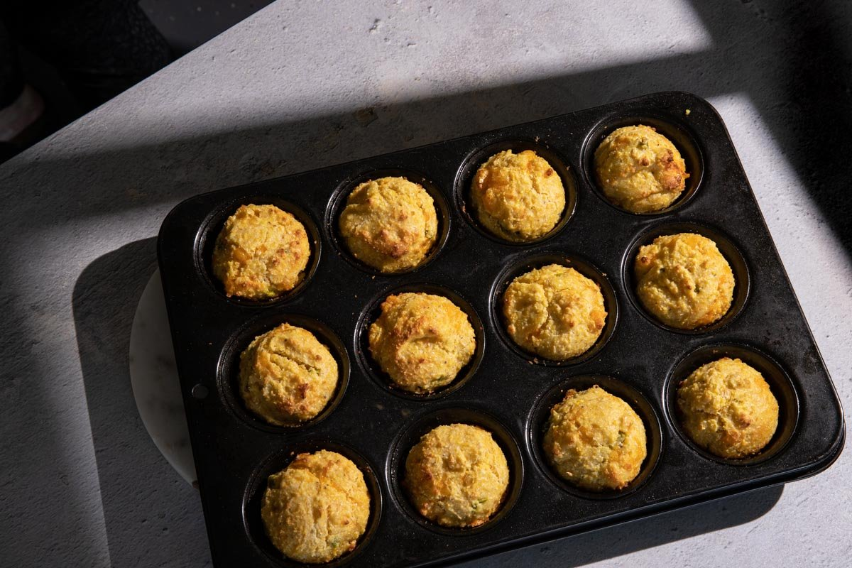 Jalapeno cheddar cornbread muffins baked in a muffin tin