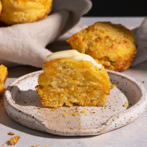 Jalapeno cheddar cornbread muffin with butter on a plate