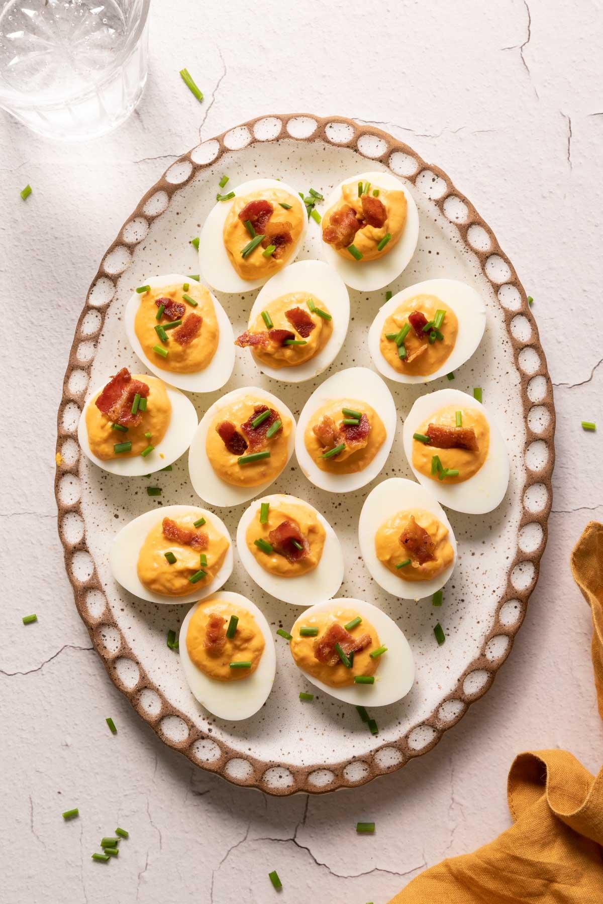 Pimento deviled eggs on an oval plate