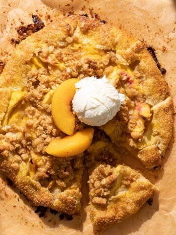 A peach crostata with a scoop of vanilla ice cream on top