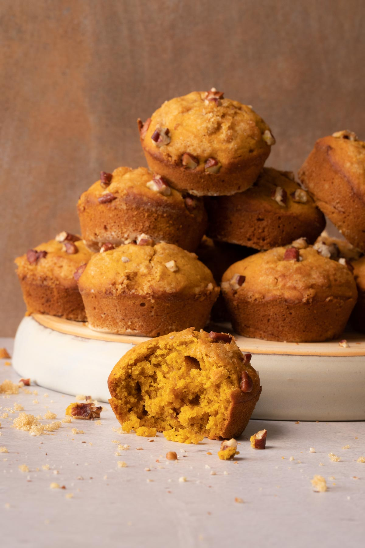 Pumpkin muffins stacked on a plate