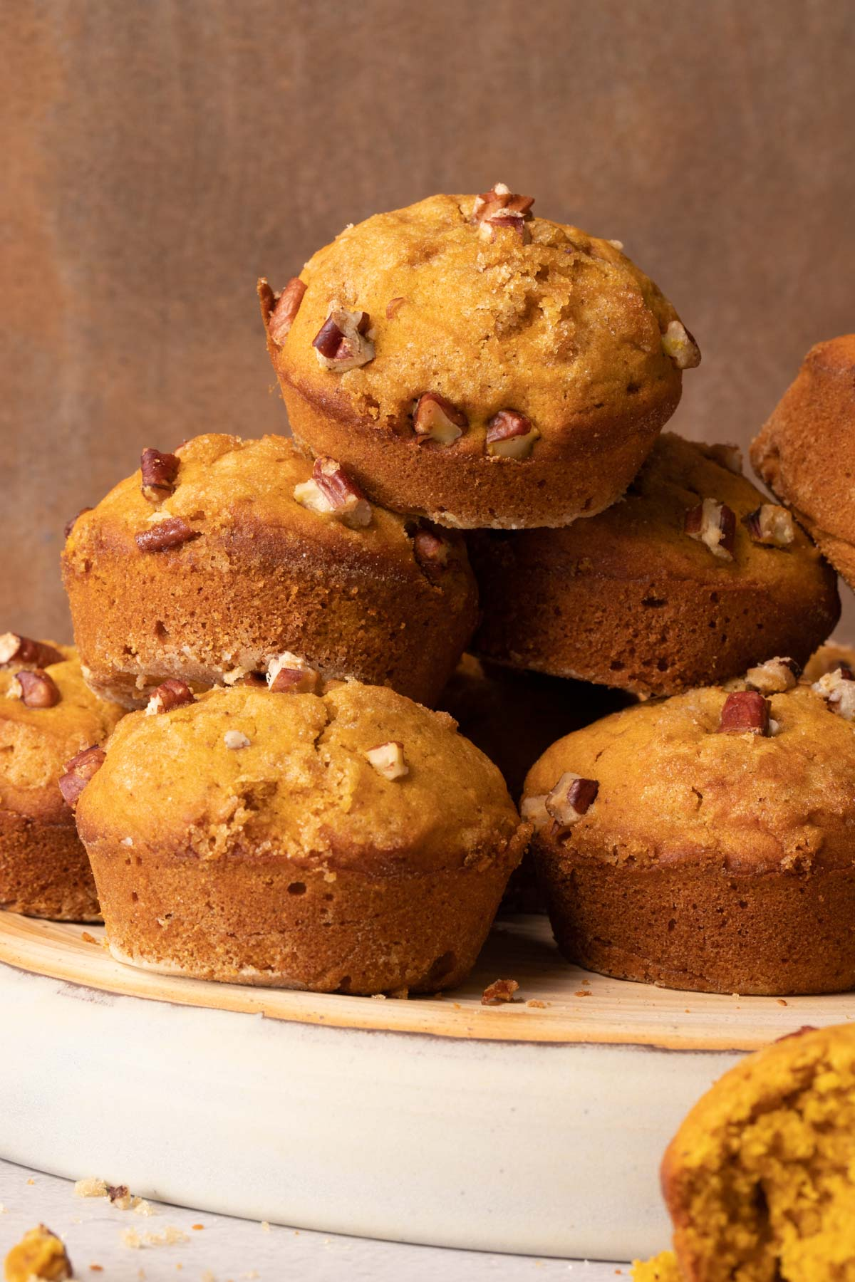 Pumpkin muffins stacked on a pottery plate