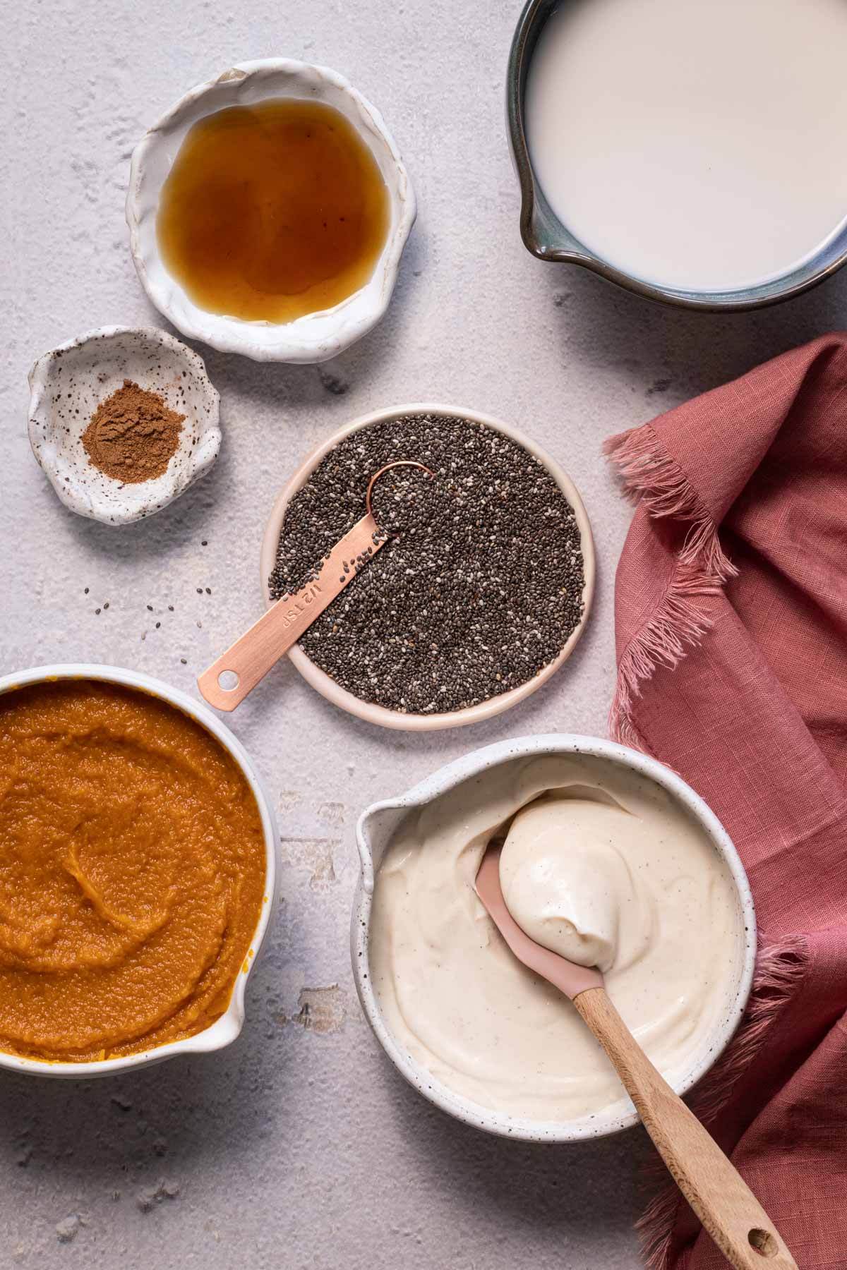 Ingredients for pumpkin chia pudding in bowls